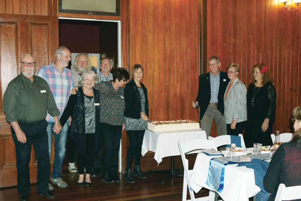 Charter Members cutting the 10th Anniversary Cake