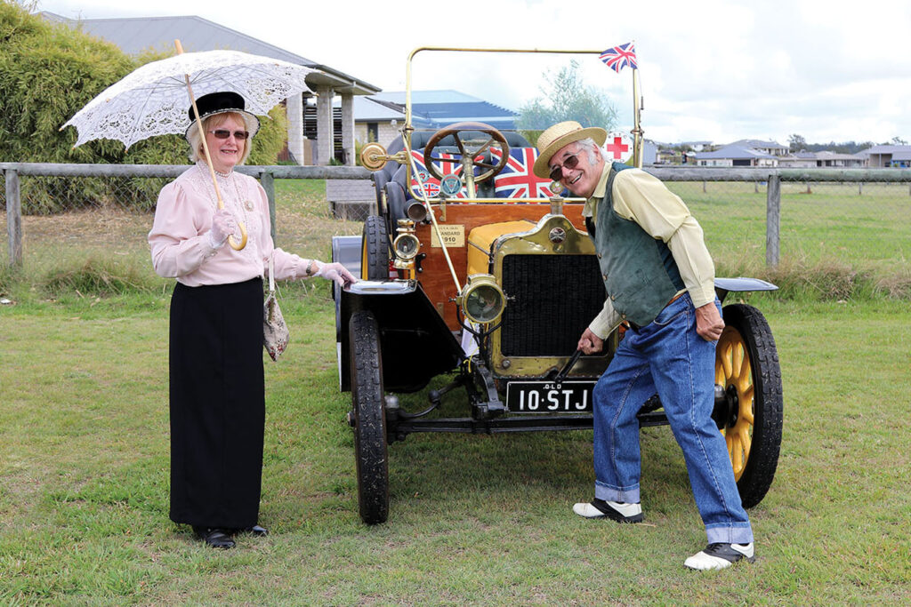Syd 'cranks' the car with Pauline