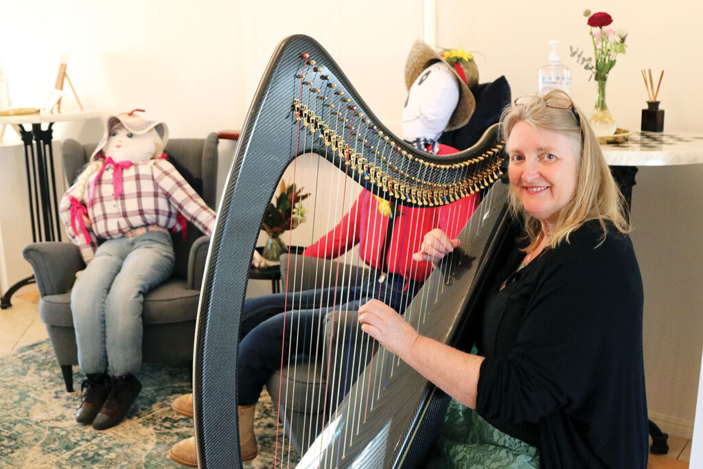 Harpist, Kathryn Foster playing at the Scarecrow High Tea