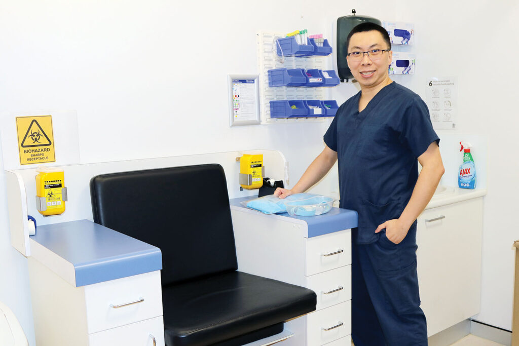 Dr James Su shows the new pathology collection chair