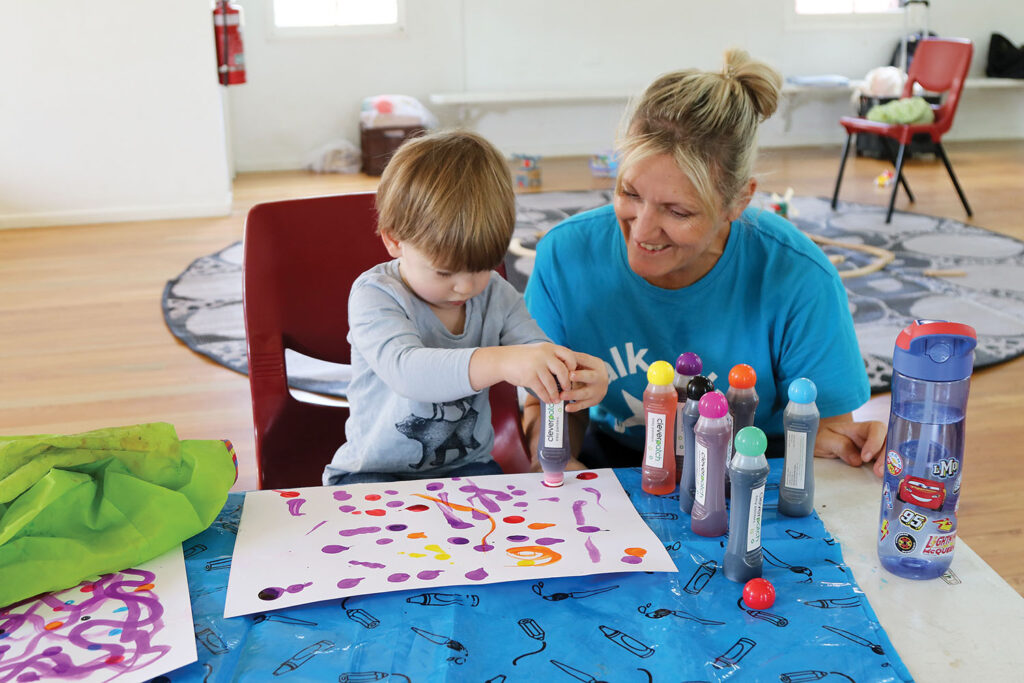 Gabriel enjoys dot painting with Heidi from First Five Forever