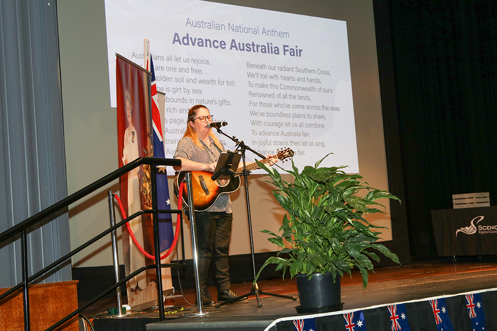 Leading the audience in the Australian Anthem